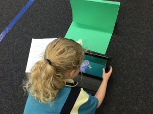 Students use mini green screens, puppets and storyboards to share three important milestones in their lives